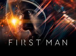 First Man showing star Ryan Gosling's head in profile in a space suit helmet