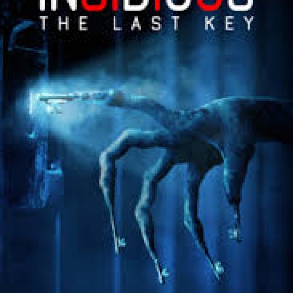 insidious the last key with a demon skeleton reaching into a lit keyhole