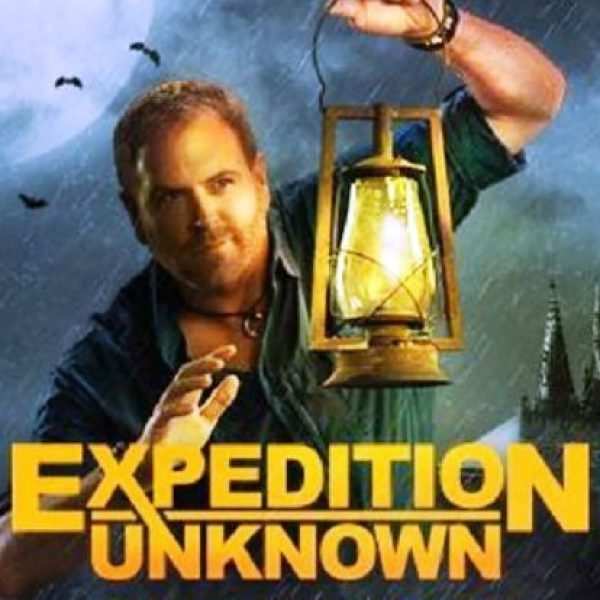 Expedition Unknown star Josh Gates holding a lantern