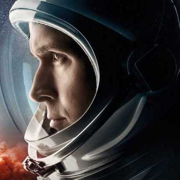 First Man poster with star Ryan Gosling in profile as Neil Armstrong in Helmet