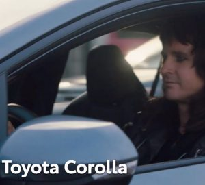 Toyota Corolla with a male driver in metal makeup