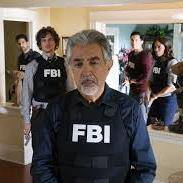 Criminal Minds cast in FBI vests with a gray haired Joe Mantegna in the forefront