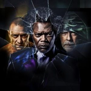Glass stars James McAvoy, Samuel L. Jackson and Bruce Willis looking ominous behind a broken pane of glass