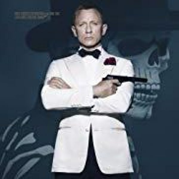 Spectre star Daniel Craig as James Bond in white tuxedo jacket holding a gun in his right hand with arms crossed
