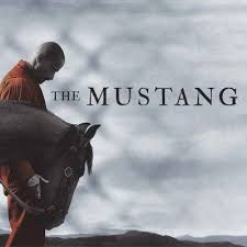The Mustang banner with man and horse