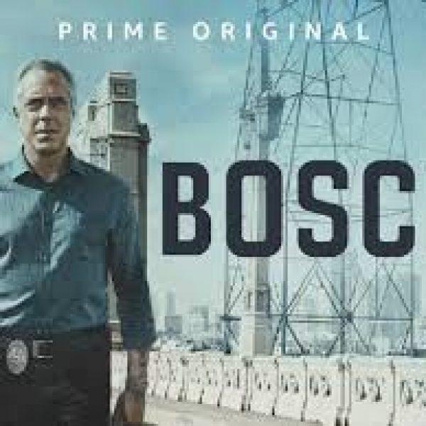 BOSCH stands on a bridge, a metal tower behind him. An Amazon Original.