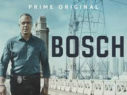 BOSCH stands on a bridge, a metal tower behind him. An Amazon Original.